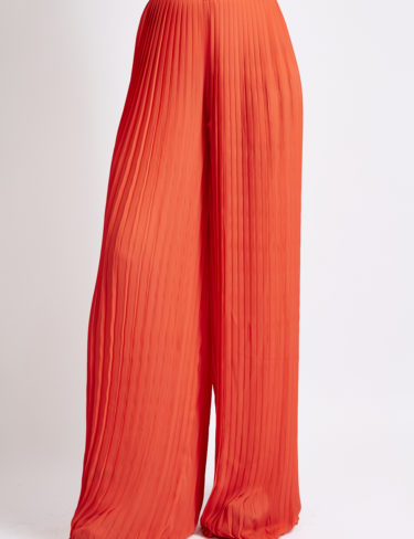 Red crinkle pleated wide leg trousers