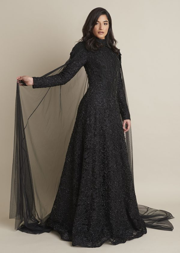 Black Laced Dress With a Detached Cape